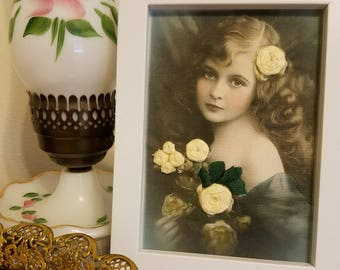 Victorian girl with yellow flowers