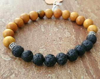 Essential oil diffuser bracelet with black volcanic and wooden beads.