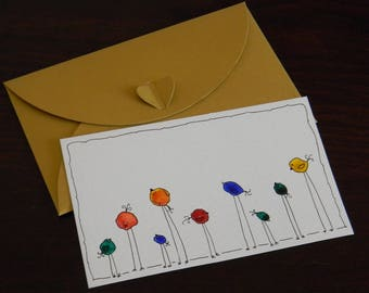 Greeting card with funny little birds and gold envelope