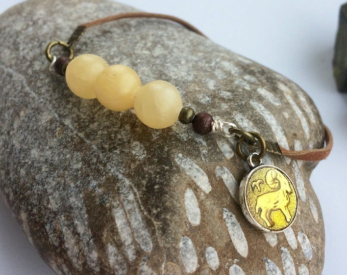 Aries Bracelet on Faux Suede Thong with Birthstone Topaz and Charm