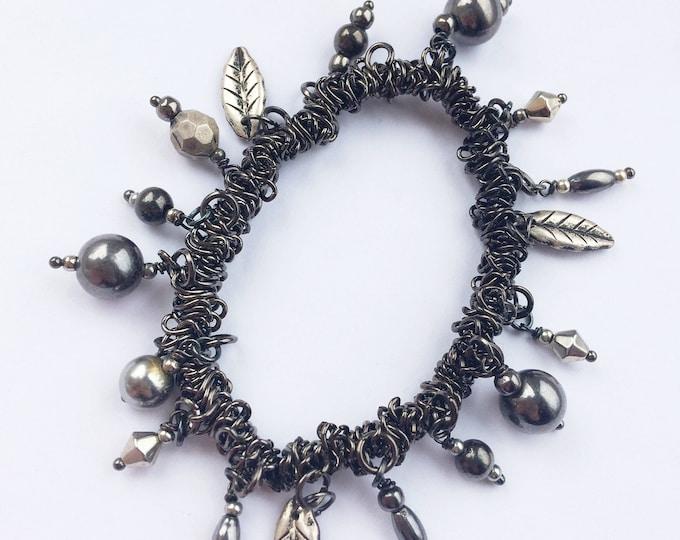 Black/Silver Stretch Hematite Charm Bracelet with Leaf Charms