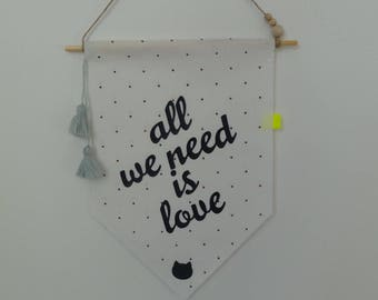 "Wall flag or door plaque ""All we need is love"" - and her kitten."