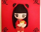 Chinese girl in kimono with her bowl of noodles