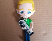 "Figure ""The blond playing melodica"""