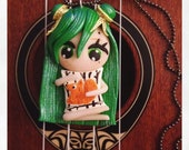 Young girl with green hair holding a pillow with squirrel pattern in her hands