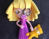 Little blonde with candy sugar lollipop