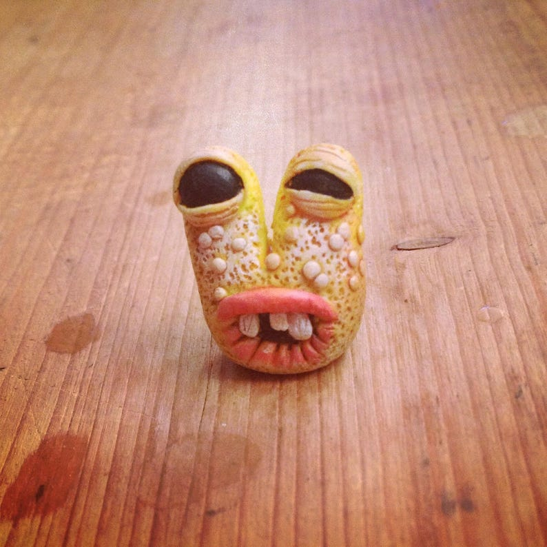 The wide apart eyes yellow Monster mini sculpture image 0