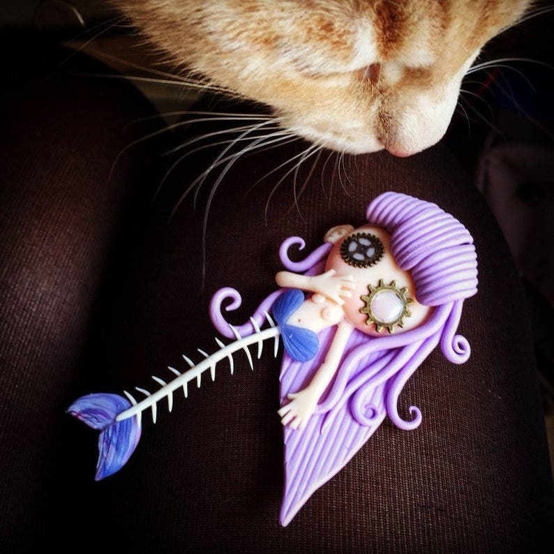 Remnants of mermaid nibbled by a kitten image 0
