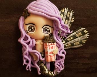 Popcorn-eating mermaid in starfish