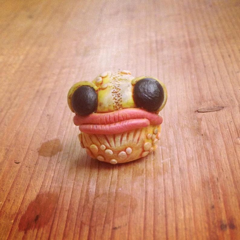 Yellow Monster mini frog head sculpture image 0