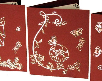 Set of 3 greeting cards, red, gold designs of fairies and flowers stickers.