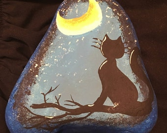 Cat with full moon rock.
