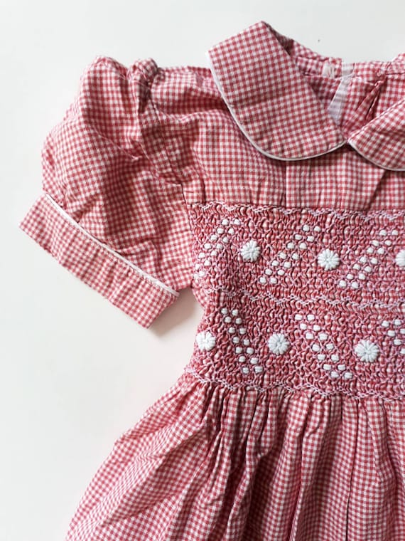 2-year-old dress vichy retro and vintage. White an