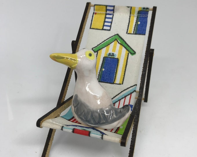 Brighton Seagull on his beach hut deck chair. Great gift for any beach, sea and sun loving friend or family member for a Birthday etc.
