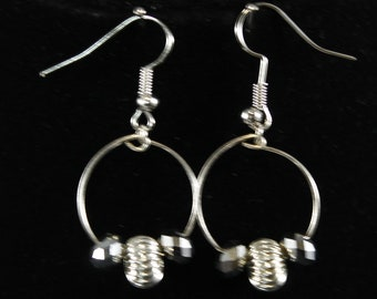 Wire hoop with silver like beads