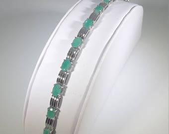 Silver bracelet with Emeralds
