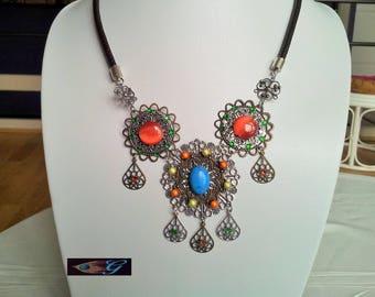 Blue and orange rosette necklace cast in bronze