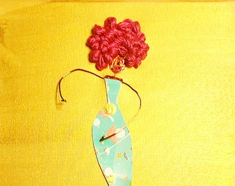 Woman with pink afro in blue dress with gold background