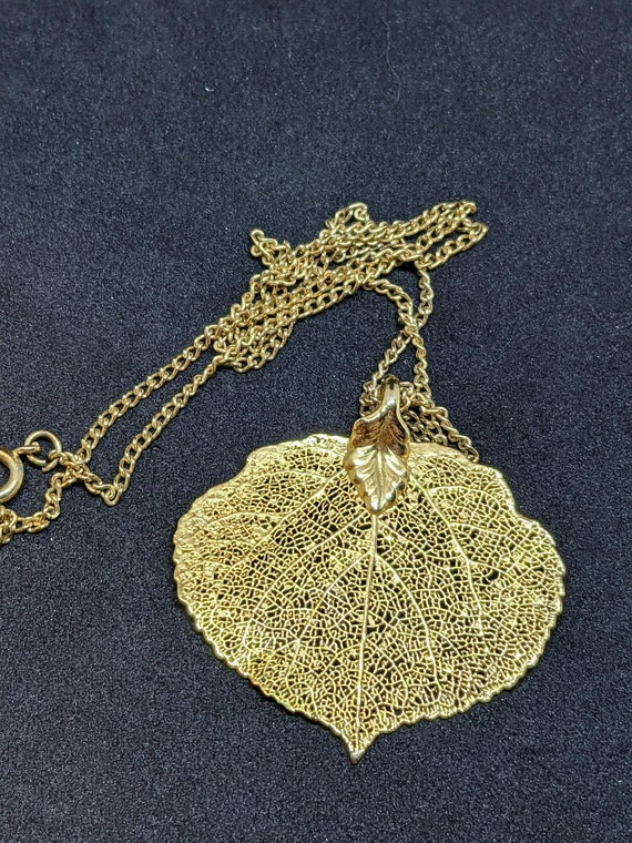 Vintage gold tone metal aspen leaf dangling pierced earrings with snowflakes ; about 1 in long