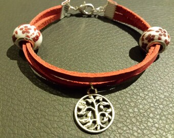 Red leather tree of life bracelet.