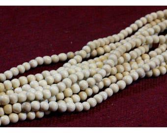 Strand 40 cm of beads 5 / 6mm white wood
