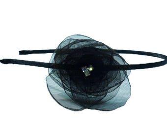 Headband flower with three rhinestone in the Center. Black