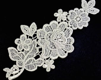 Ivory lace fabric flower.