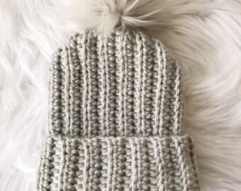Crochet gray hat with faur fur pom pom