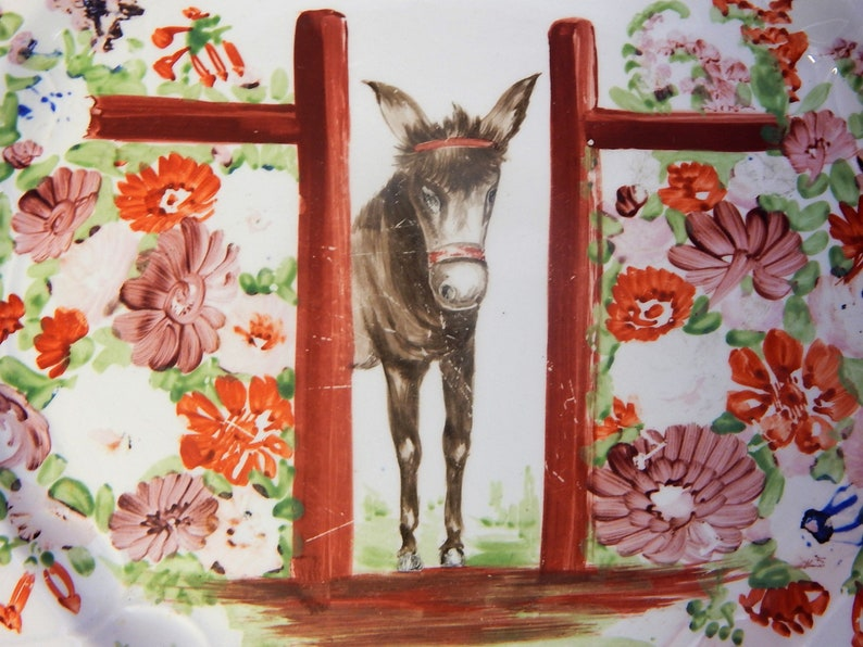Another Donkey looking through a gateway Hand painted on an antique Staffordshire plate.