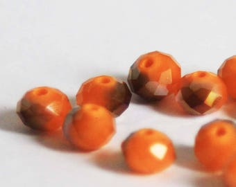 Faceted glass bead orange and Bronze