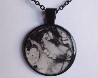 11 Strange Creature Collages resin pendant necklace