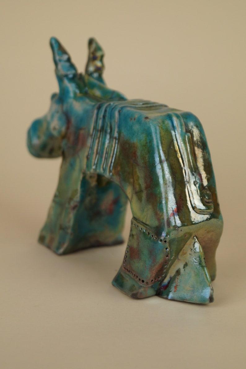 Ceramic donkey figurine fired in raku