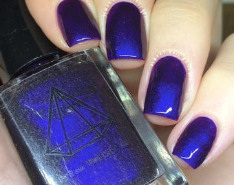 Nothing Else Matters, a deep purple that shifts blue and red UK handmade indie nail polish