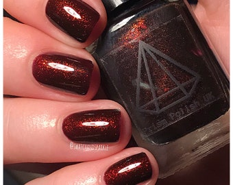 Drogon - a plum base filled with red/gold/green colour shifting micro flakies UK indie handmade nail polish