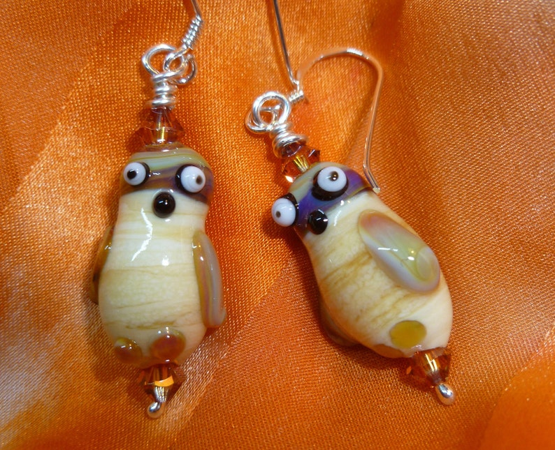 Owl earrings in brown and gold image 0