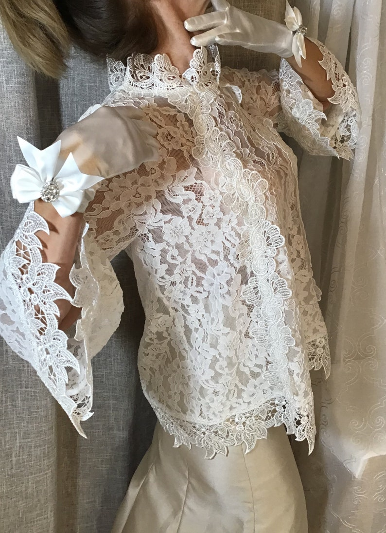 Ivory long sleeve lace blouse with clear sequined trim.Bridal image 0