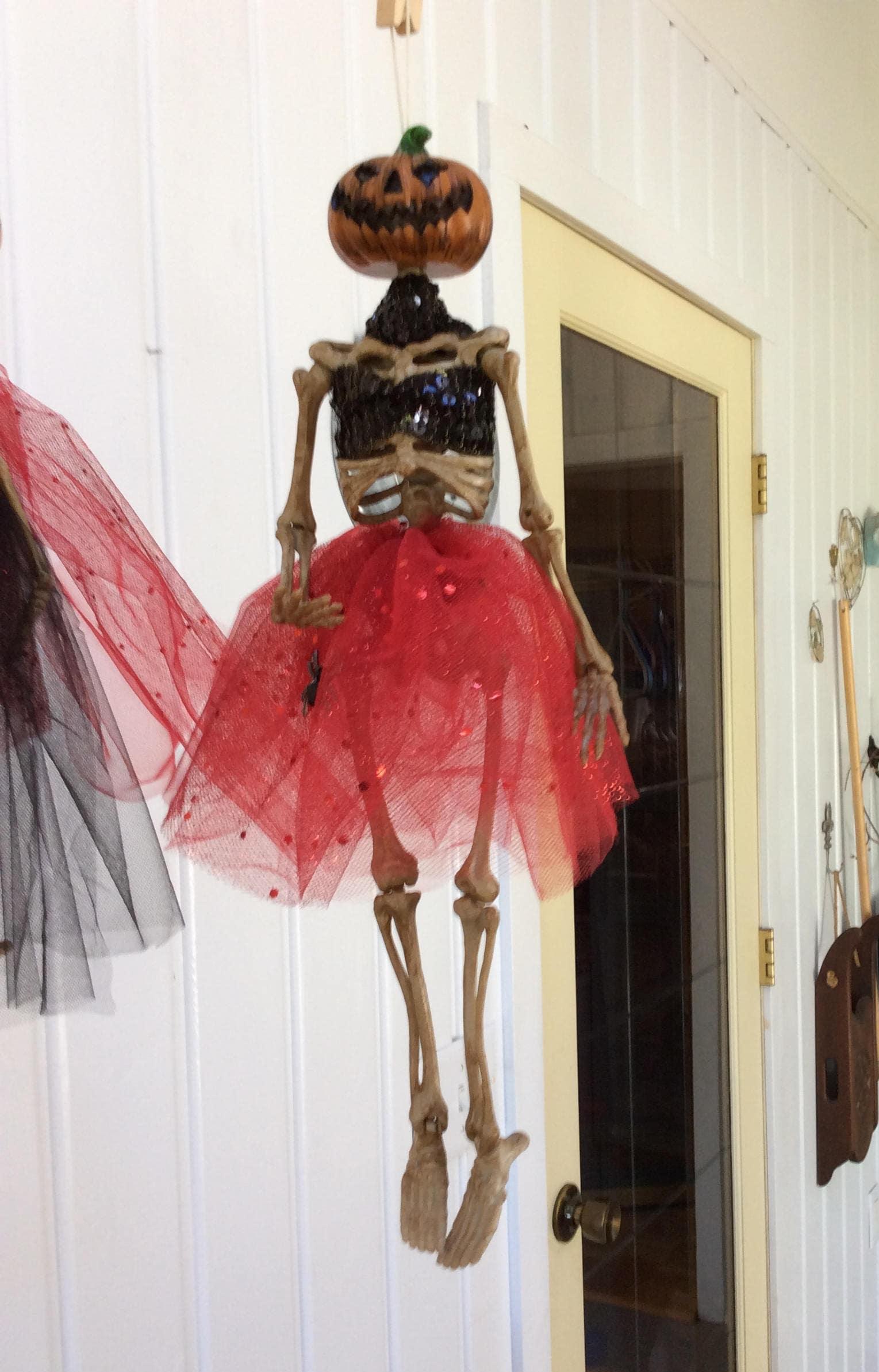 778b2041384 Dressed Skeleton 18 Hanging Skeleton short red skirt