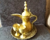 Vintage Middle Eastern DALLAH coffee pot.brass with a beautiful decorated brass enamelled plate and 2 cups. Turkish .Islamic coffee pot set