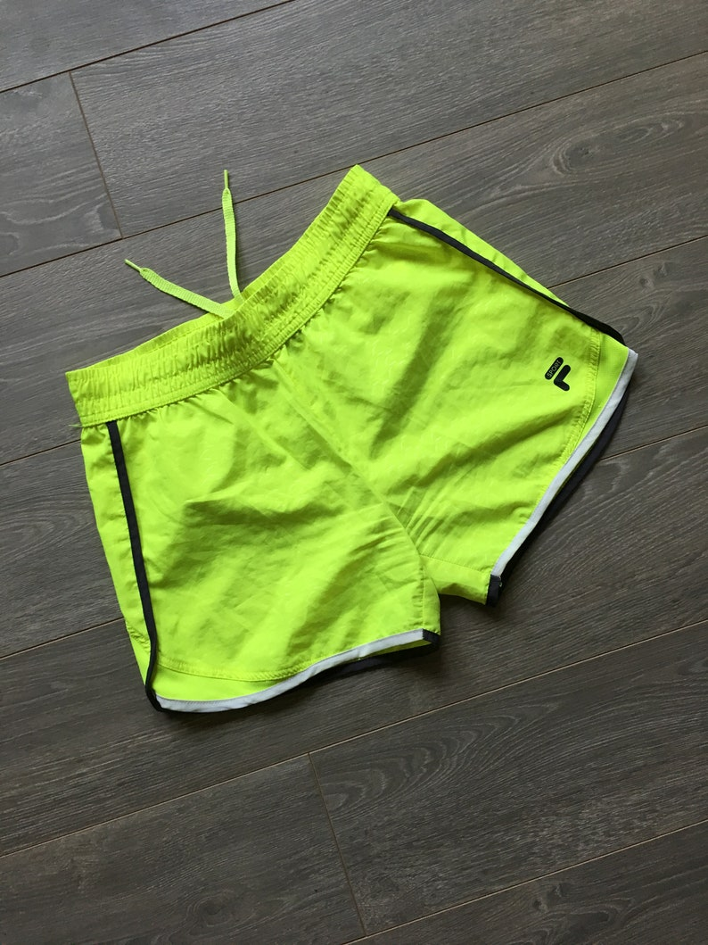 b1f006be0c3dd Vintage neon shorts womens L fila sport flourescent yellow booty shorts  running shorts cute workout shorts mermaid rare vintage hot fitness
