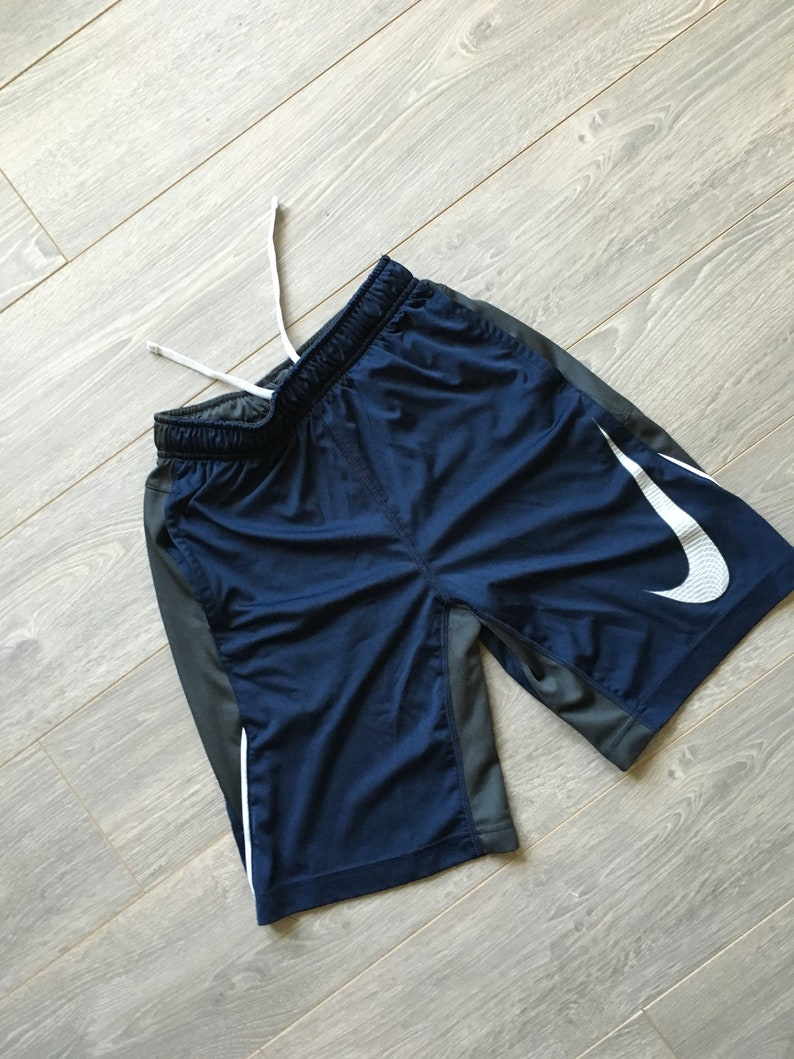 1341f14db9d10 Kids vintage nike shorts size youth medium size M big swoosh obsidian and  gunmetal rare deadstock vintage shorts basketball sporty vintage