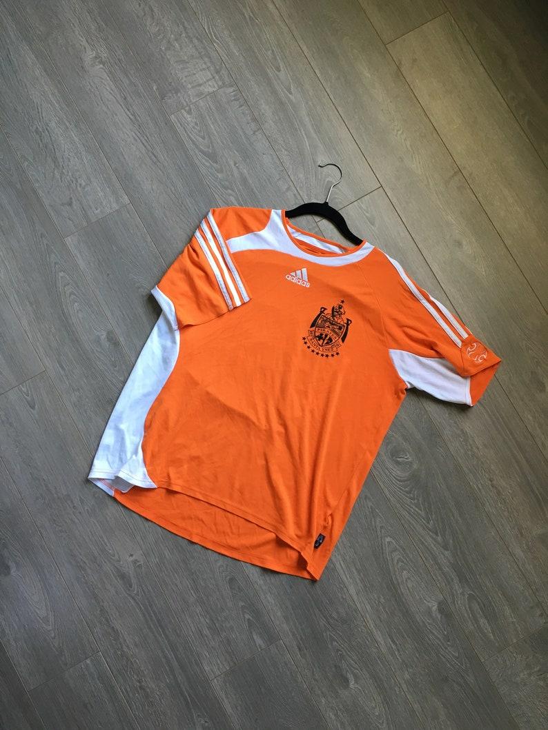 ce8d1f58f Vintage adidas shirt orange adidas pirates soccer jersey big