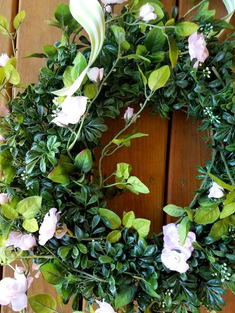 Faux boxwood and wild roses wreath