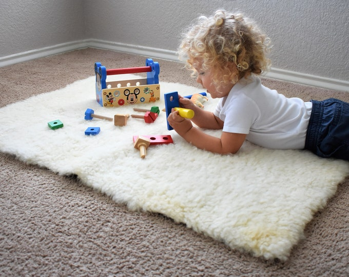 White Sheepskin Toddler Toys and Games Rug