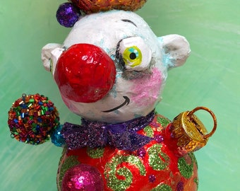 "26"" Mache Snowman with Traditional Ornaments and a tree on a purple glass base"