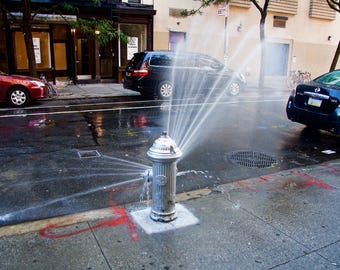 An open Fire Hydrant is always welcome in a New York Summer. East Village. New York. USA