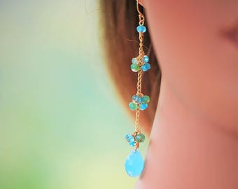Blue chalcedony drops with apatite, chrysoprase and jade clusters.