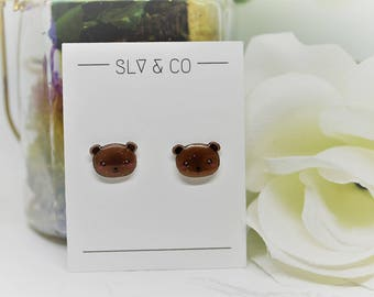 V - Kawaii bear shrink plastic stud earrings with silver closure coated with glitter resin