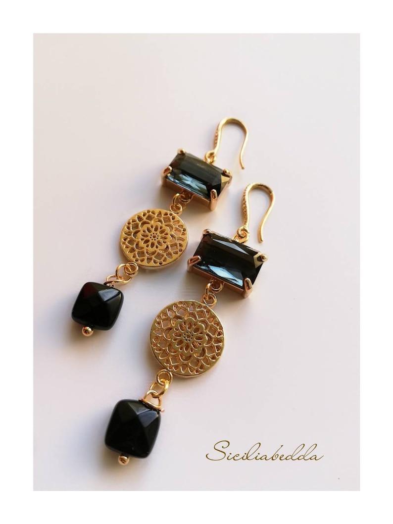 Earrings with black zircons