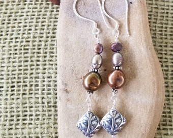 Dangling Chocolate freshwater Pearl, 2 earth tone colored pearl nuggets and sterling silver Bali floral bead. Strung on SS earwire.
