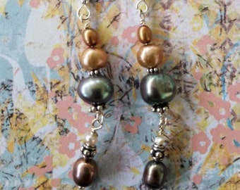 String of Pearl earrings.  4 Colorful Pearl's of different shapes and sizes dangling on sterling silver earwire.